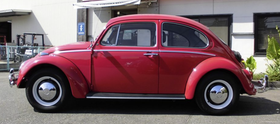Stock Red VW Beetle with Stock Wheels